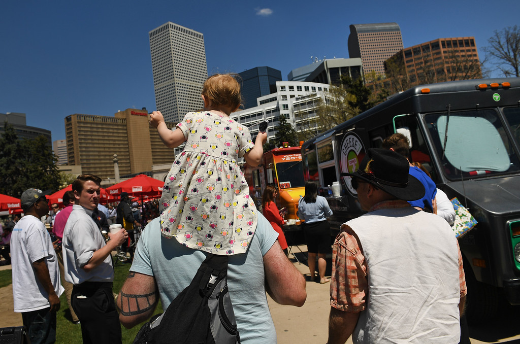 . Dave Jackson tours the food trucks with his daughter Vivian Donachy, 2, a top his shoulders at Civic Center Park on the first day of the 11th annual Civic Center EATS on May 3, 2016 in Denver, Colorado. (Photo by Helen H. Richardson/The Denver Post)