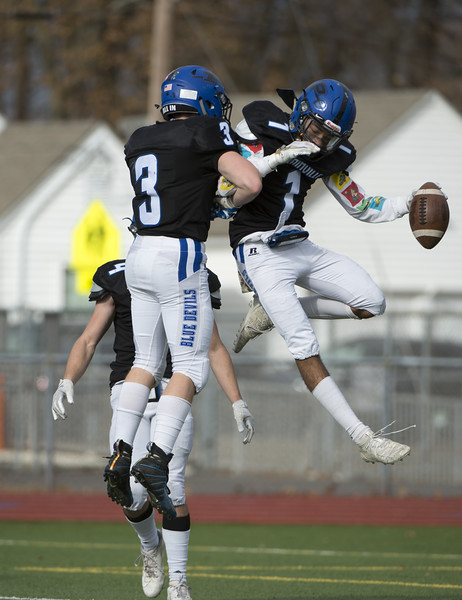 11/28/19  Wesley Bunnell | Staff  Plainville football defeated Farmington on Thanksgiving morning at Plainville High School. WR Javan Paradis (1) celebrates his touchdown reception with teammates.