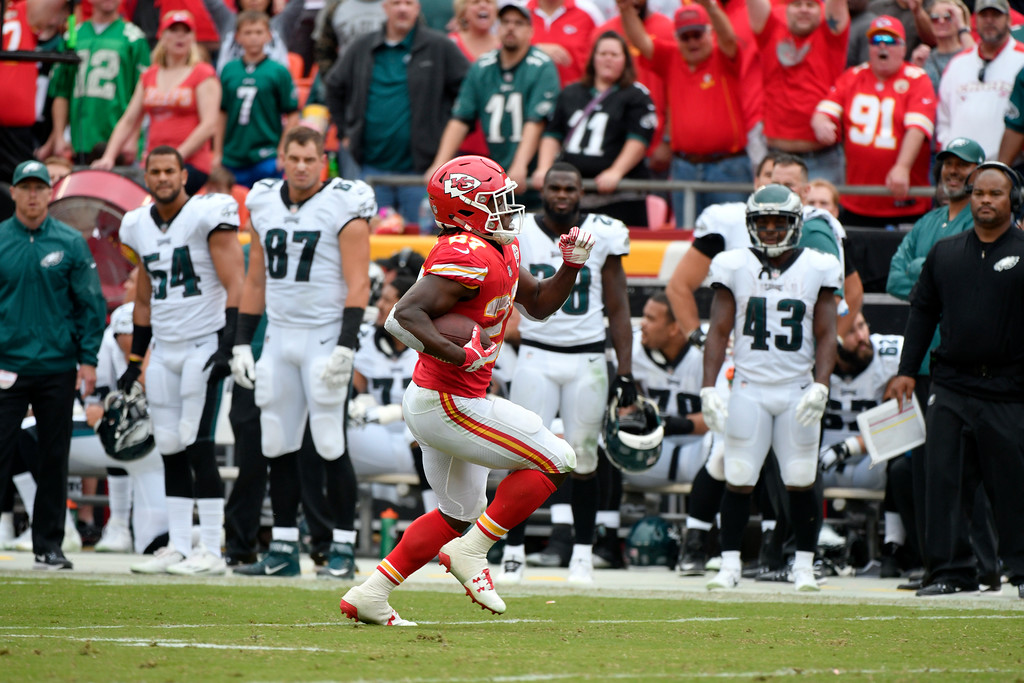 . Kansas City Chiefs running back Kareem Hunt (27) runs past Philadelphia Eagles players for a 53 yard touchdown, during the second half of an NFL football game in Kansas City, Mo., Sunday, Sept. 17, 2017. (AP Photo/Ed Zurga)