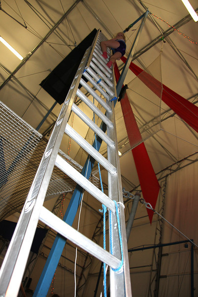 Amelia blazes up the ladder and goes first