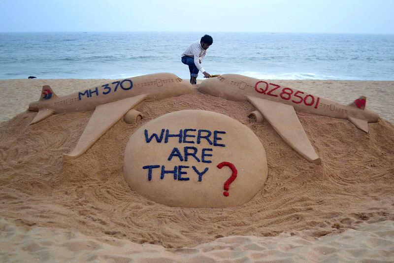 . Indian sand artist Sudarsan Pattnaik gives the final touches to his sand sculpture portraying two missing aircraft, Air Asia QZ8501 and Malayasia Airlines MH370 on Golden Sea Beach at Puri, some 65 kms east of Bhubaneswar on December 29, 2014.  An AirAsia Airbus plane with 162 people on board went missing en route from Surabaya in Indonesia to Singapore early on December 28, officials and the airline said, in the third major incident to affect a Malaysian carrier this year.   AFP PHOTO/STRSTRDEL/AFP/Getty Images
