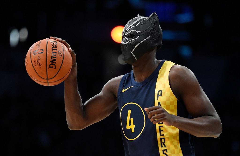""". Indiana Pacers\' Victor Oladipo gets ready for a dunk while wearing a mask from the movie \""""Black Panther\"""" during the NBA All-Star basketball slam dunk contest Saturday, Feb. 17, 2018, in Los Angeles. (AP Photo/Chris Pizzello)"""