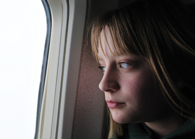 Clare looking out the airplane window.