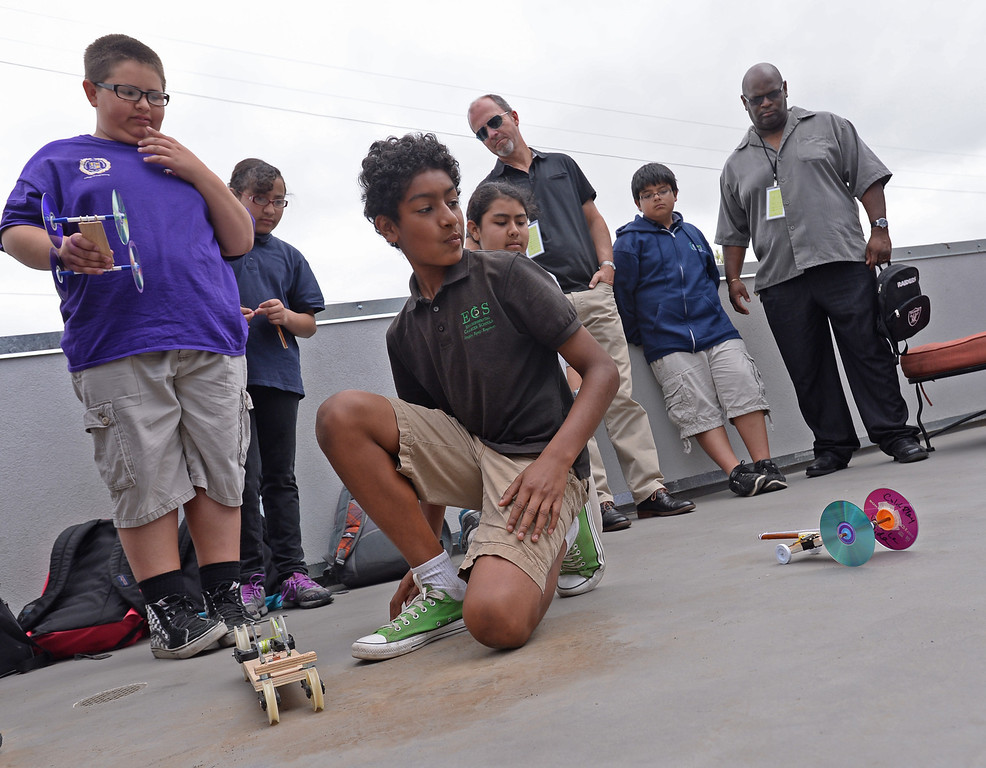 . New Environmental Charter Middle School in Gardena is located on the property of a former church. It serves about 360 students. Juan Briseno, 7th grade center, lines up mousetrap powered cars built for class project. Photos by Brad Graverson 5-22-13