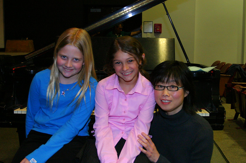 Anisa with Annie and her piano teacher, Ms Sien.