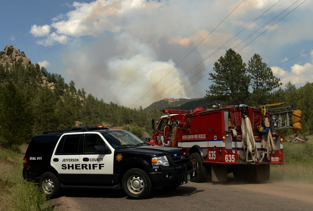. CONIFER, CO. - June 19: Lime Gulch Fire in Jefferson County. Conifer, Colorado. June 19, 2013. A fire engine is heading to the fire site. (Photo By Hyoung Chang/The Denver Post)
