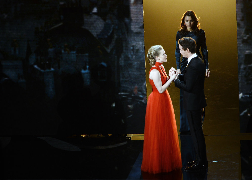 Description of . Actress Amanda Seyfried, actress Samantha Barks and actor Eddie Redmayne perform onstage during the Oscars held at the Dolby Theatre on February 24, 2013 in Hollywood, California.  (Photo by Kevin Winter/Getty Images)