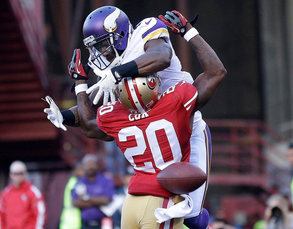 . 49ers defensive back Perrish Cox commits a pass interference penalty on Vikings wide receiver Greg Jennings during the second quarter. (AP Photo/Marcio Jose Sanchez)
