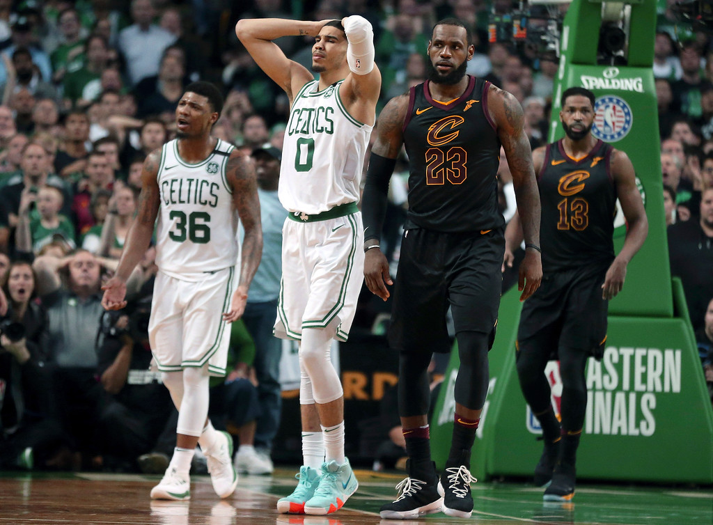 . Boston Celtics guard Marcus Smart (36) and forward Jayson Tatum (0) react in front of Cleveland Cavaliers forward LeBron James (23) during the second half in Game 7 of the NBA basketball Eastern Conference finals, Sunday, May 27, 2018, in Boston. (AP Photo/Elise Amendola)