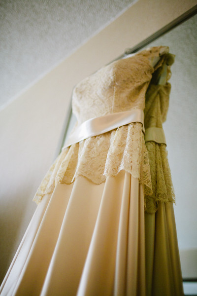 wedding gown in front of mirror
