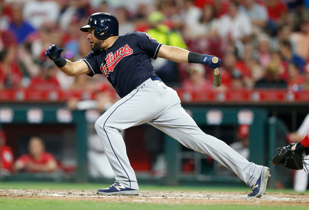 . Cleveland Indians\' Melky Cabrera follows through on a two-run single off Cincinnati Reds relief pitcher Amir Garrett during the sixth inning of a baseball game, Monday, Aug. 13, 2018, in Cincinnati. (AP Photo/Gary Landers)