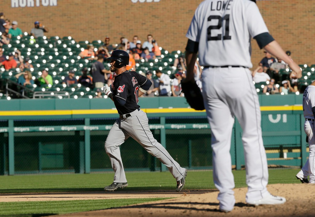 . Detroit Tigers relief pitcher Mark Lowe stands on the mound as Cleveland Indians\' Yan Gomes rounds the bases after his solo home run during the ninth inning of a baseball game, Saturday, June 25, 2016 in Detroit. (AP Photo/Carlos Osorio)
