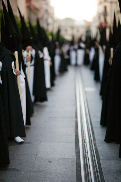 Lines of hooded penitents, Holy Week, Seville, Spain