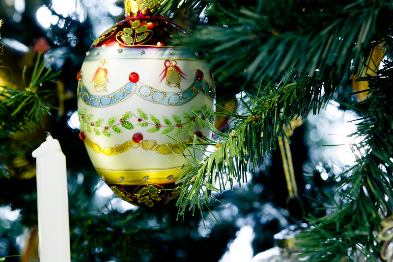 . A delicately detailed ornament holds court on one of the Christmas trees at the Governor\'s mansion. Photo by Mark Broste