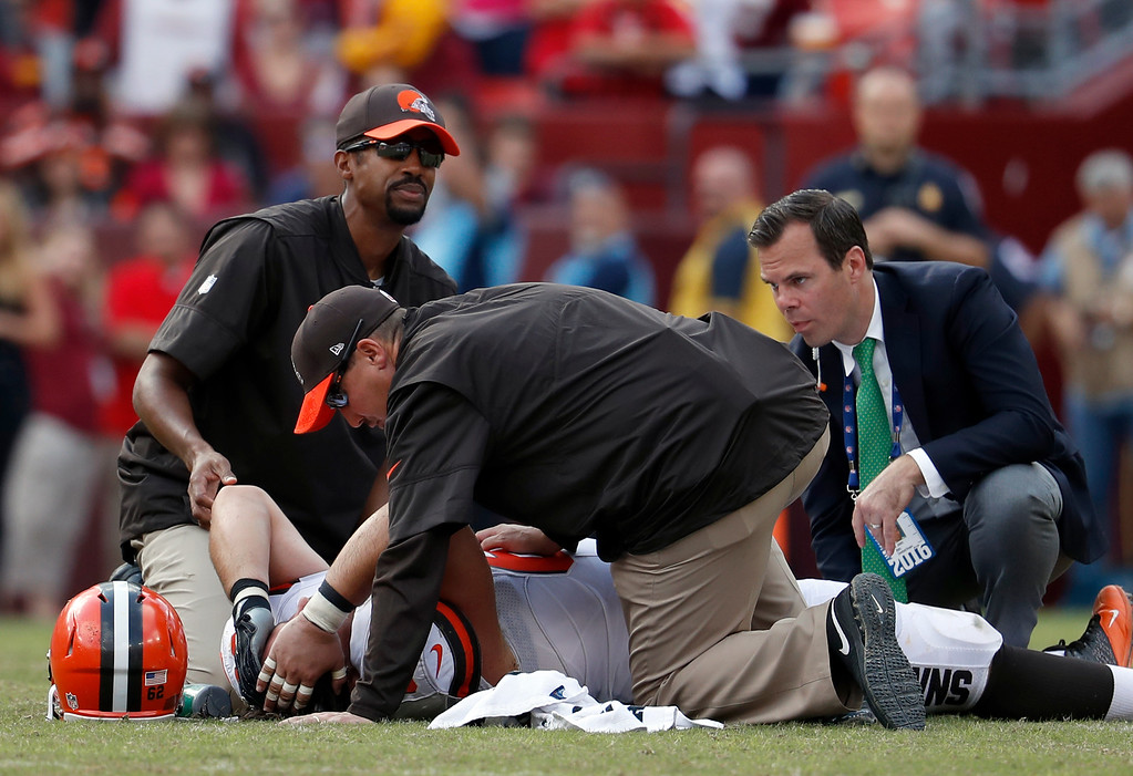 . Cleveland Browns center Austin Reiter (62) is attended to after an injury during the second half of an NFL football game against the Washington Redskins, Sunday, Oct. 2, 2016, in Landover, Md. The Redskins won 31-20. (AP Photo/Carolyn Kaster)