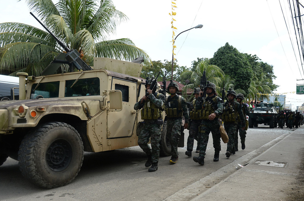 . Members of Philippine national police special forces arrive to reinforce soldiers during a fire fight between government forces and Muslim rebels as stand-off entered its fourth day in Zamboanga City on the southern island of Mindanao on September 12, 2013.   AFP PHOTO/TED ALJIBE/AFP/Getty Images