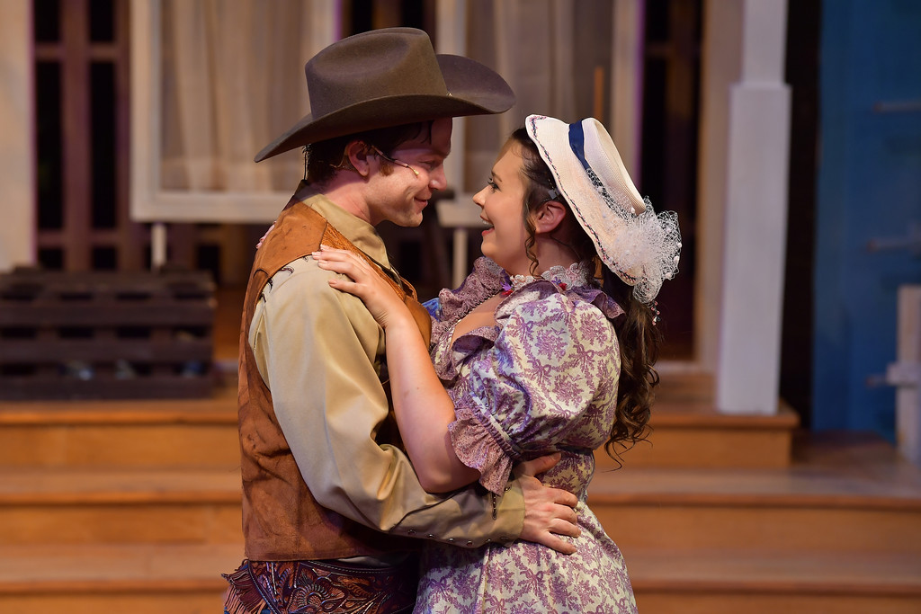 ". Christopher Tuck, as Will Parker, and Samantha Russell, as Ado Annie, perform in the Porthouse Theatre production of ""Oklahoma!\"" The show continues through Aug. 12 at the Cuyahoga Falls venue. For more information, visit kent.edu/porthouse. (Bob Christy)"