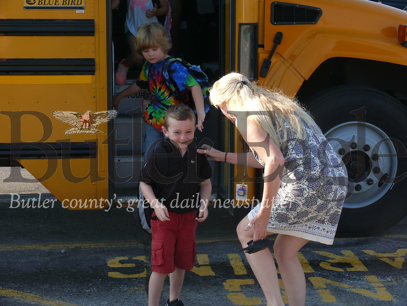 Elizabeth McMahon, Mars Primary Center principal and school district assistant superintendent, greets students as they arrive at the school Wednesday.
