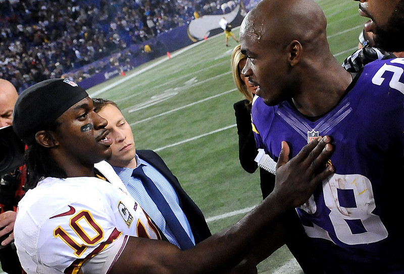 . Minnesota Vikings running back Adrian Peterson, right, talks with Washington Redskins quarterback Robert Griffin III after the game. (Pioneer Press: Sherri LaRose-Chiglo)
