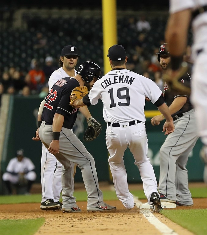 . Cleveland Indians\' Jason Kipnis is caught in a rundown at third by Detroit Tigers relief pitcher Louis Coleman (19) during the seventh inning of a baseball game, Tuesday, May 15, 2018, in Detroit. (AP Photo/Carlos Osorio)