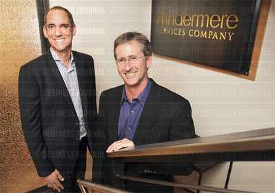Reknown economist Matthew Gardner (left) and Geoff Wood, chief executive officer of Windermere, are pictured in the company's headquarters in Seattle, Washington