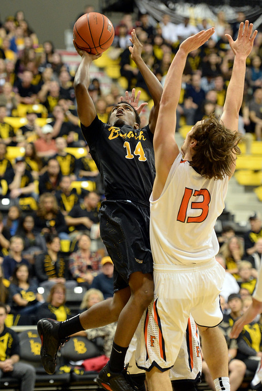 . Long Beach\'s Branford Jones (14) arches one in around Fullerton\'s Joe Boyd (13) in a Big West mens basketball game at the Pyramid Saturday, February 01, 2014, Long Beach CA.   Long Beach won 75-56. CSU Long Beach versus CSU Fullerton Photo by Steve McCrank/Daily Breeze
