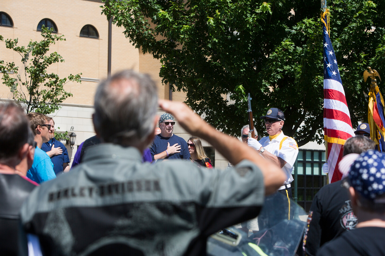 John Moffitt says the Pledge of Allegiance  as seen through the salute of a fellow motorcycle rider.
