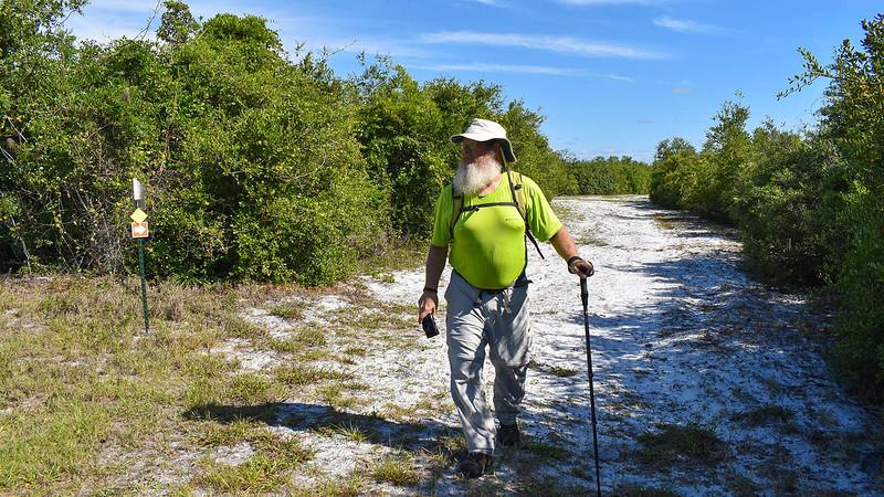 John walking on sand road