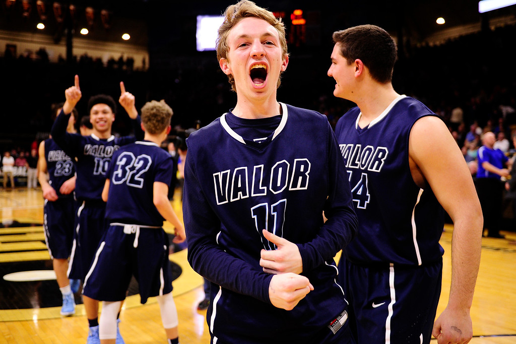 . Grant Adams (11) of Valor Christian yells after defeating Longmont at the Coors Events Center on March 11, 2016 in Boulder, Colorado. Valor Christian defeated Longmont 58-53 to advance to the 4A finals of Colorado state basketball tournament.  (Photo by Brent Lewis/The Denver Post)