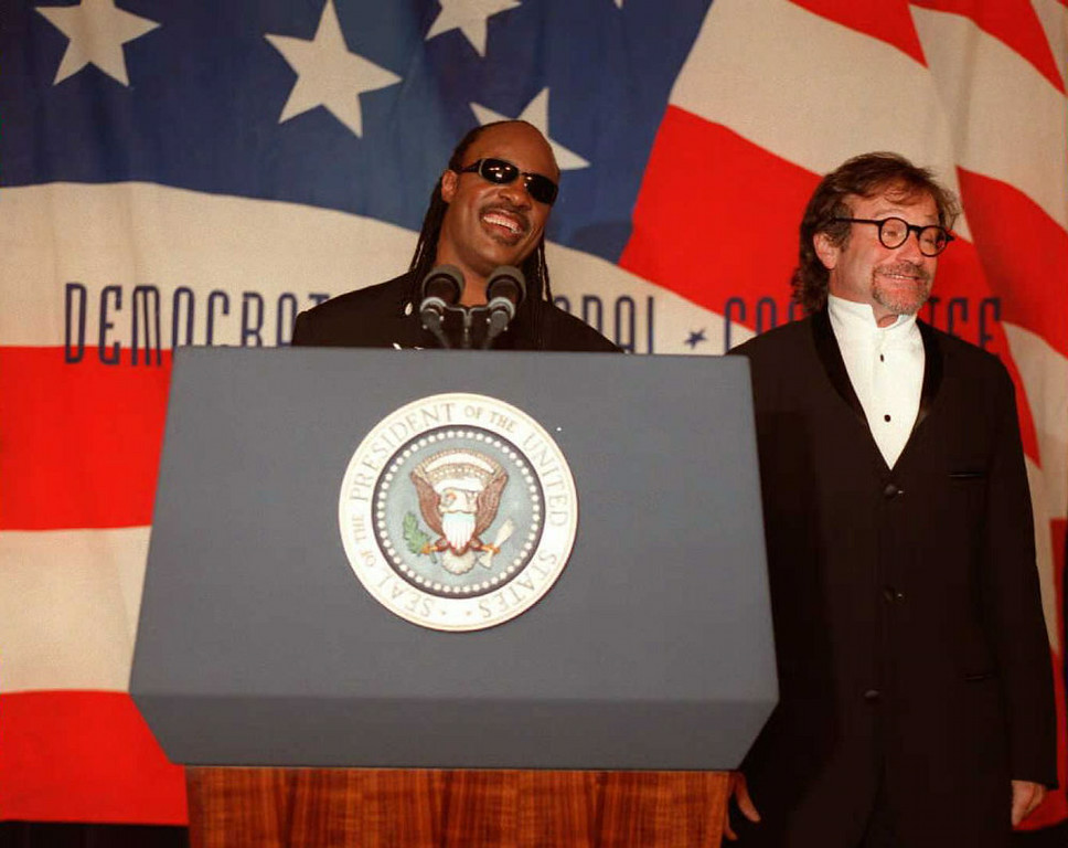 ". Singer Stevie Wonder(L) and comedian Robin Williams(R) joke with members of ""The Saxaphone Club,\"" a club for younger members of the Democratic Party, in Washington 09 May. US President Bill Clinton later spoke at the club after he attended a fund raising event for the Democratic National Committee(DNC) earlier in the evening.  PAUL RICHARDS/AFP/Getty Images"