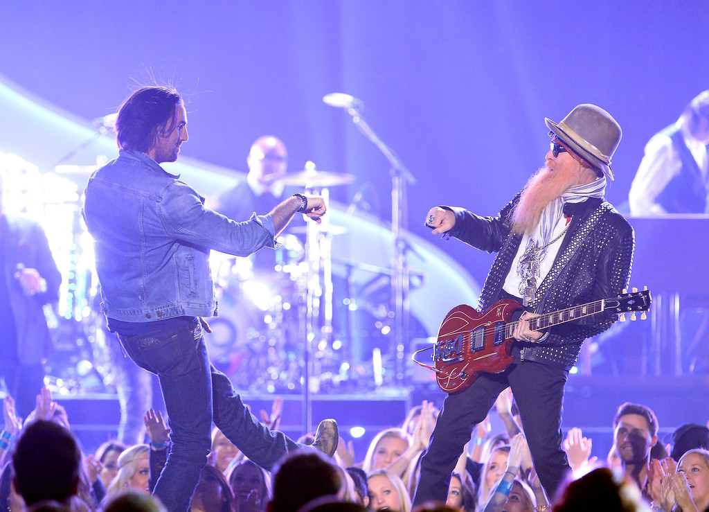 . Recording artists Jake Owen (L) and Billy Gibbons perform onstage during the 2013 American Country Awards at the Mandalay Bay Events Center on December 10, 2013 in Las Vegas, Nevada.  (Photo by Ethan Miller/Getty Images)