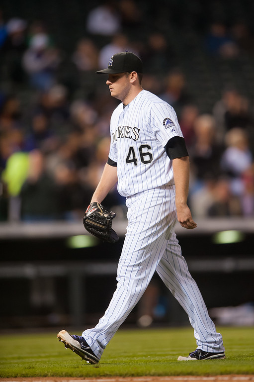 . DENVER, CO - SEPTEMBER 05:  Tyler Matzek #46 of the Colorado Rockies walks off the field after completing the eighth inning of a game against the San Diego Padres at Coors Field on September 5, 2014 in Denver, Colorado.  (Photo by Dustin Bradford/Getty Images)
