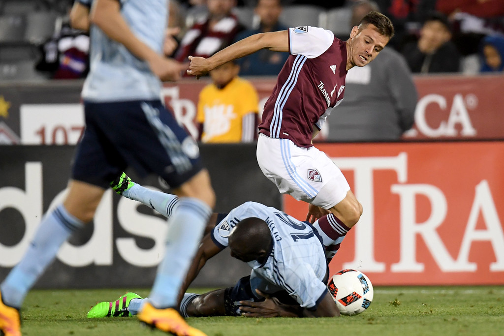 . COMMERCE CITY, CO - MAY 11: Luis Solignac (21) of Colorado Rapids and Lawrence Olum (16) of Sporting Kansas City tangle during the second half of the Rapids\' 1-0 win. The Colorado Rapids hosted Sporting Kansas City on Wednesday, May 11, 2016. (Photo by AAron Ontiveroz/The Denver Post)