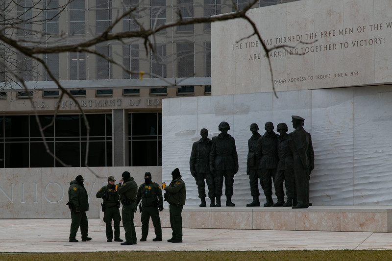 A group of U.S. Border Patrol officers gather outside of the Department of Education on the morning of inauguration