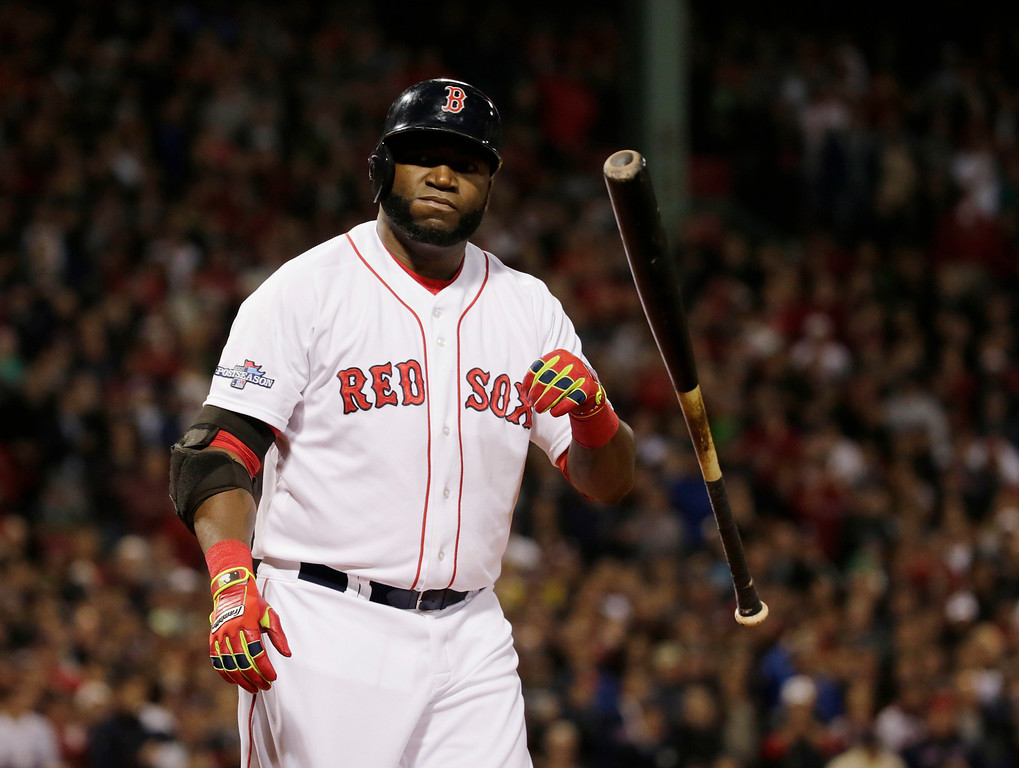 . Boston Red Sox designated hitter David Ortiz tosses his bat after striking out in the first inning during Game 1 of the American League baseball championship series against the Detroit Tigers  Saturday, Oct. 12, 2013, in Boston. (AP Photo/Charles Krupa)