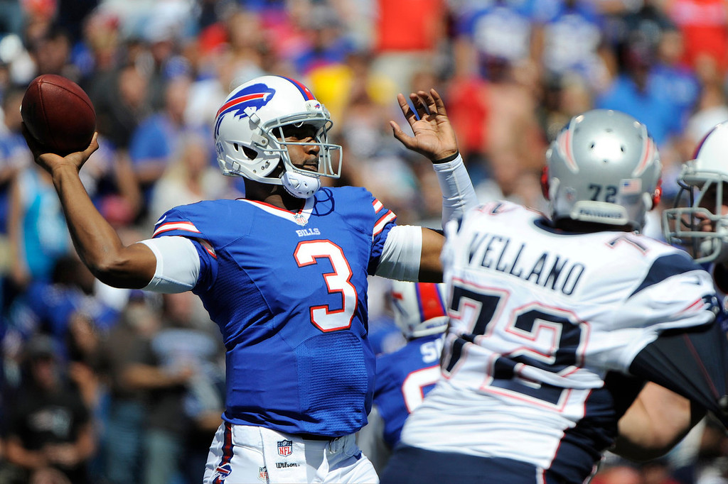. Buffalo Bills quarterback EJ Manuel (3) throws a pass during the first half of an NFL football game as New England Patriots defensive tackle Joe Vellano (72) rushes the passer on Sunday, Sept. 8, 2013, in Orchard Park. (AP Photo/Gary Wiepert)