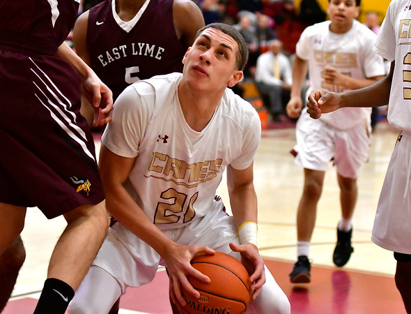 12/29/2018 Mike Orazzi | Staff New Britain's Nyzaiah Diaz (21) during basketball Saturday night in New Britain.