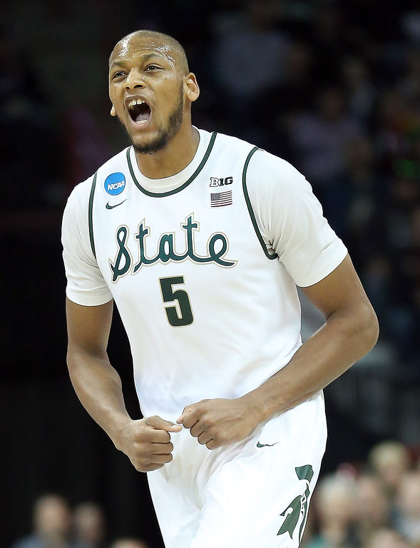 . Adreian Payne #5 of the Michigan State Spartans reacts during their game against the Delaware Fightin Blue Hens the second round of the 2014 NCAA Men\'s Basketball Tournament at Spokane Veterans Memorial Arena on March 20, 2014 in Spokane, Washington.  (Photo by Stephen Dunn/Getty Images)