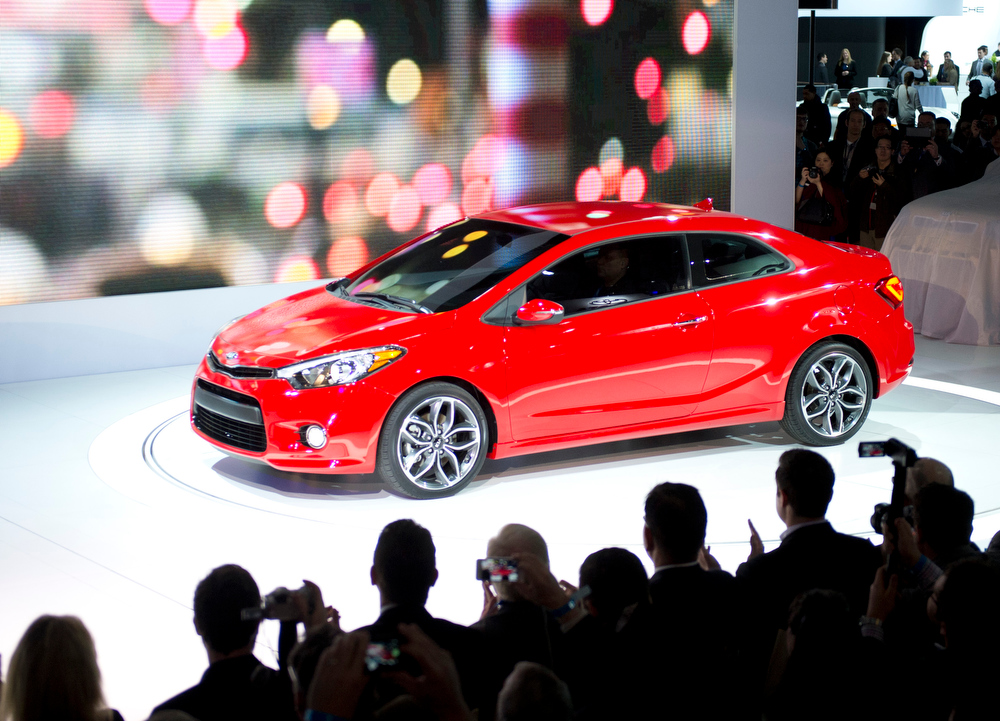 Description of . The Kia Forte Coup is introduced during a media conference at the New York International Auto show March 27, 2013 in New york. AFP PHOTO/Don EmmertDON EMMERT/AFP/Getty Images
