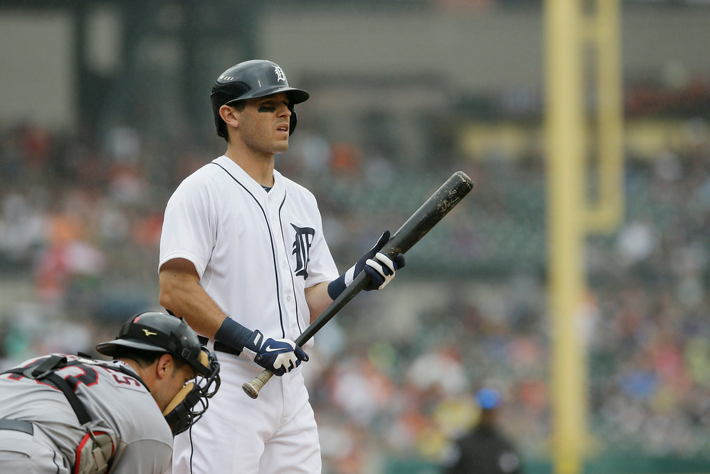 . Detroit Tigers\' Ian Kinsler bats during the fifth inning in the first baseball game of a doubleheader against the Cleveland Indians, Saturday, July 19, 2014 in Detroit. (AP Photo/Carlos Osorio)