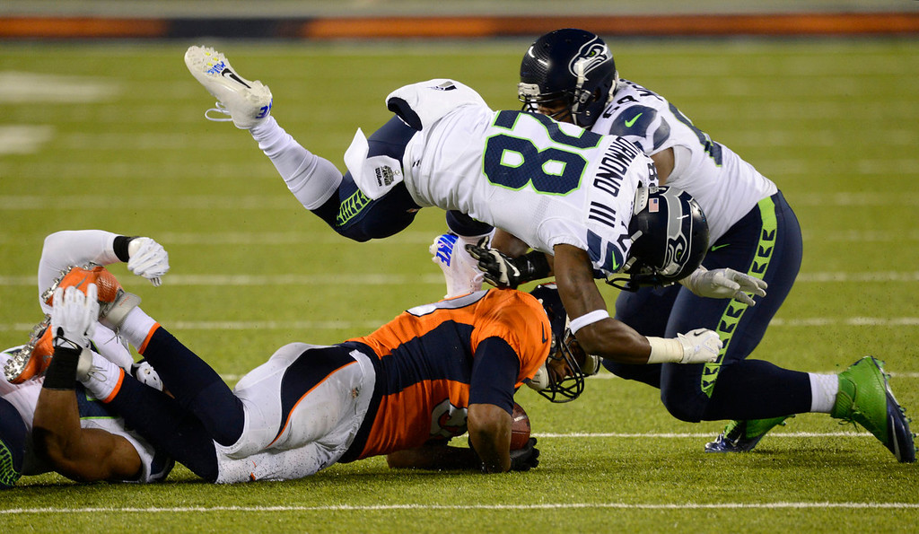 . Denver Broncos tight end Julius Thomas (80) gets taken down hard during the first quarter. The Denver Broncos vs the Seattle Seahawks in Super Bowl XLVIII at MetLife Stadium in East Rutherford, New Jersey Sunday, February 2, 2014. (Photo by AAron Ontiveroz/The Denver Post)