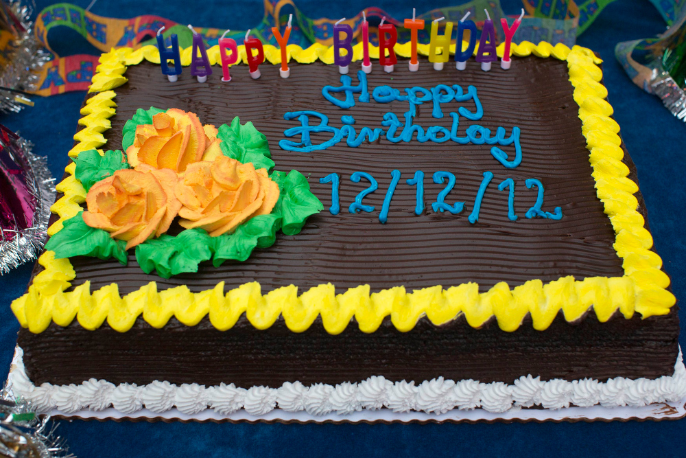 Description of . A cake awaits a group of children who celebrated their 12th birthday in Times Square, New York December 12, 2012. The date, written as 12/12/12 is the last major numerical date using the Gregorian or Christian calendar for almost another century. REUTERS/Andrew Kelly