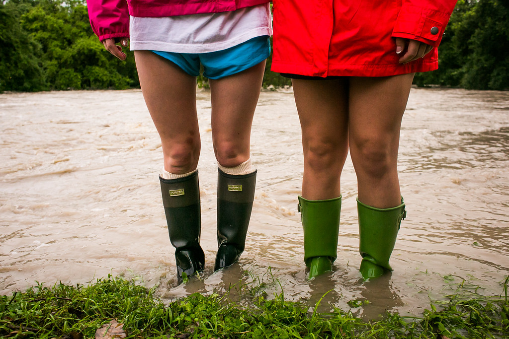 . AUSTIN, TX - MAY 25:   Amy Lohr and Marian McCoy stand in the flooding at Shoal Creek after days of heavy rain on May 25, 2015 in Austin, Texas. Texas Gov. Greg Abbott toured the damage zone where one person is confirmed dead and at least 12 others missing in flooding along the Rio Blanco, which reports say rose as much as 40 feet in places, caused by more than 10 inches of rain over a four-day period. The governor earlier declared a state of emergency in 24 Texas counties.  (Photo by Drew Anthony Smith/Getty Images)
