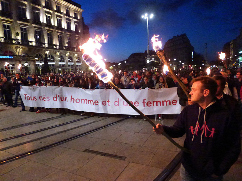 """. Demonstrators opposed to same-sex marriage protest on April 23, 2013 in Bordeaux after the French national assembly adopted a bill legalizing same-sex marriages and adoption for gay couples, defying months of opposition protests. In its second and final reading, a majority of lawmakers approved the bill by a vote of 331 to 225. (Banner reads: \"""" All born from a man and a woman\""""). MEHDI FEDOUACH/AFP/Getty Images"""