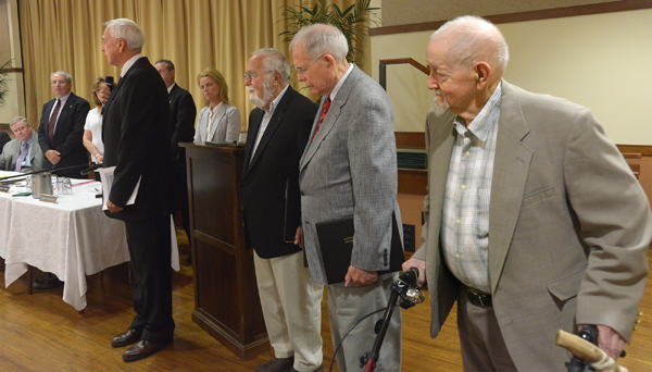 Description of . Pa. State Senator Stewart Greenleaf, left,  recognizes all the World War II veterans living at Foulkeways for their efforts during the Normandy invasion including, right to left, Francis Whittemore, William Notley, and Herbert Levy during a board of supervisors meeting held at Foulkeways Tuesday, Aug. 25, 2014. Montgomery Media staff photo by Bob Raines
