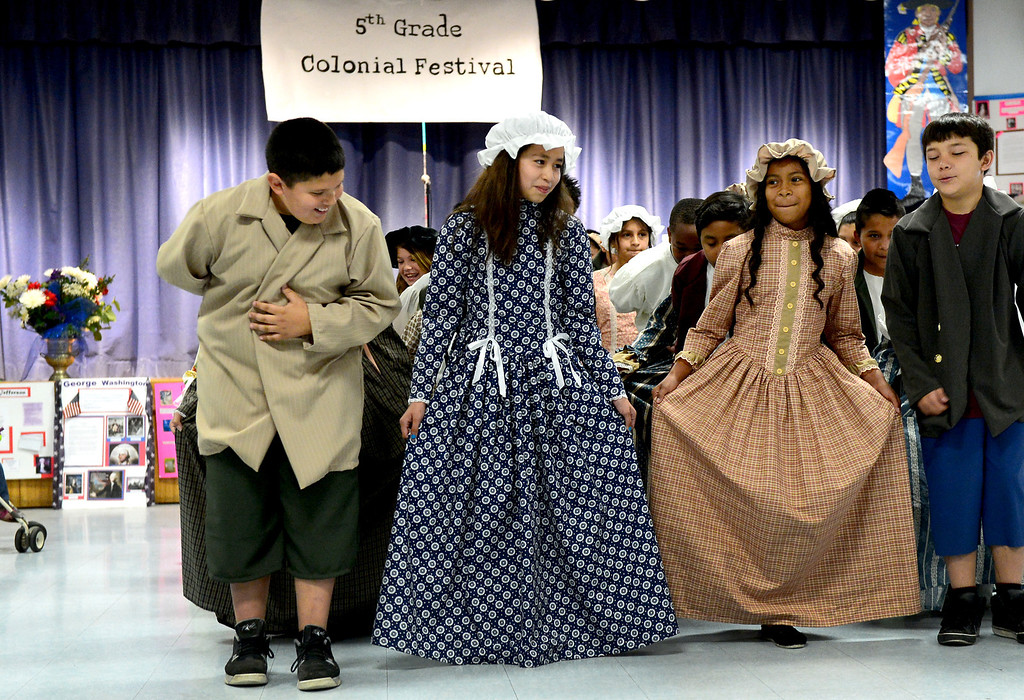 . Tracy Elementary School fifth-graders do the Minuet during a Colonial Festival Tuesday morning, March 26, 2013 at the Baldwin Park school. In one month the students completed a report, learned two songs and two dances. Grecia Herrera, the school\'s nutritional aid, made the dresses and boys\' suits. (SGVN/Staff Photo by Sarah Reingewirtz)