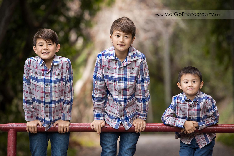 three boys in gray shirts at Carlos Bee Park in Hayward