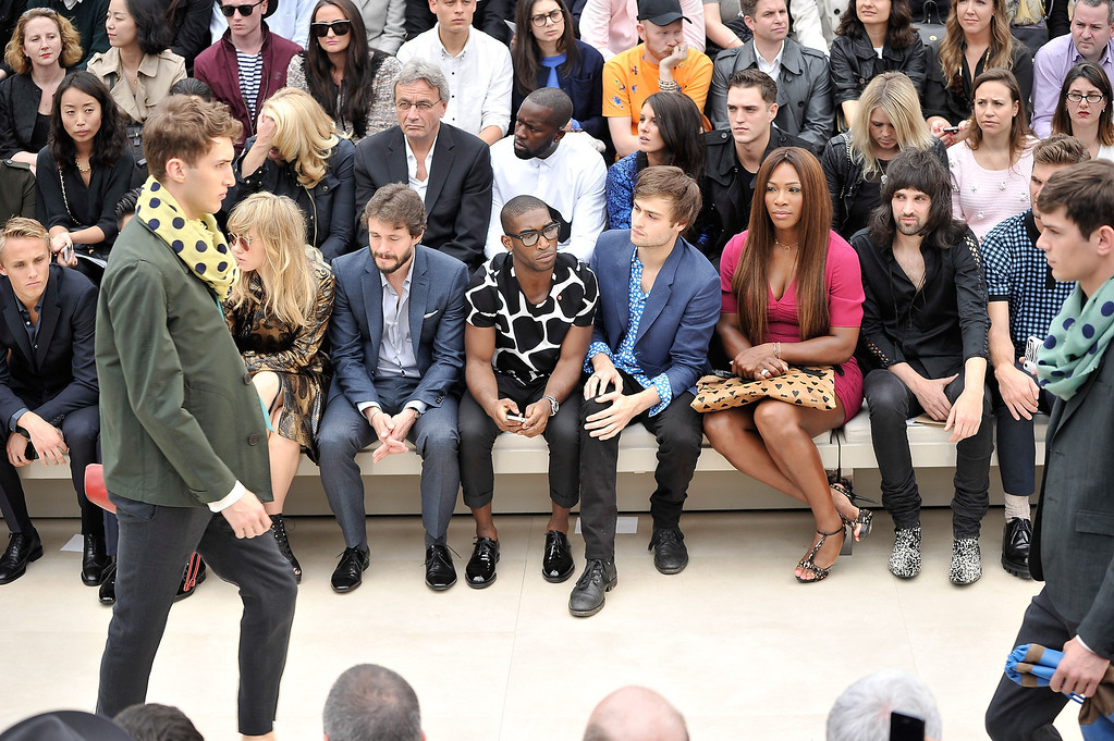 . From left, Max Chilton, Suki Waterhouse, Hugh Dancy, Tinie Tempah, Douglas Booth, Serena Williams, and Serge Pizzorno sit in the front row at Burberry Menswear Spring/Summer 2014 at Kensington Gardens on June 18, 2013 in London, England.  (Photo by Gareth Cattermole/Getty Images for Burberry)