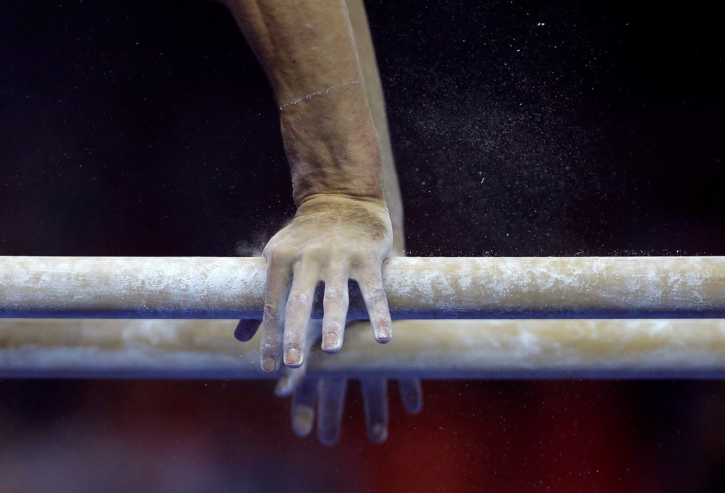 . Julien Gobaex of France competes in the parallel bars during the Artistic Gymnastics World Championships at the Guangxi Gymnasium in Nanning, the capital of southwest China\'s Guangxi Zhuang Autonomous Region Saturday, Oct. 4, 2014. (AP Photo/Andy Wong)
