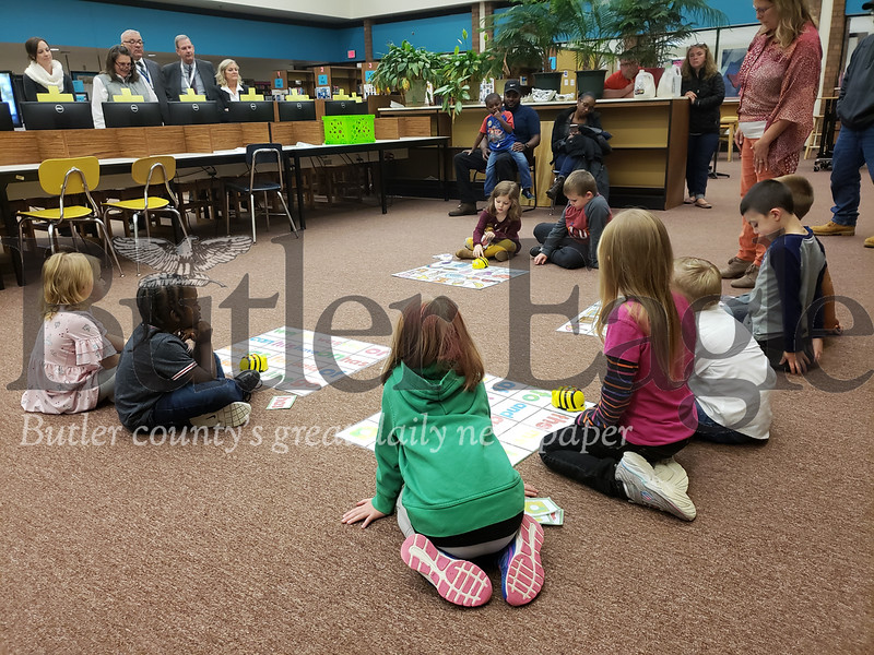 Students from Jeanie Cornell's kindergarten class started the Butler School Board's Monday night with a demonstration of bee-shaped robots they've been using to begin easing into programming. The students used buttons on the bots to dictate a route through a grid, and the machines rolled along how the children requested.  Tanner Cole/Butler Eagle